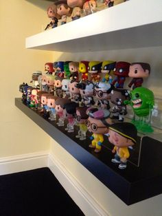 Funko collection on a floating shelf from Ikea. I got the plastic risers off ebay.