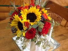 Fall brides bouquet with sunflowers and red roses