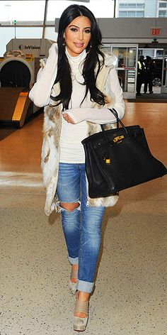 Love this whole outfit from the vest to the jeans and booties....don't even get me started on the Birkin!