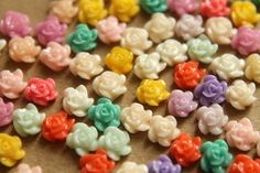 Tiny MultiColored Flower Cabochons 5mm I love miniature findings -whether they actually get used in a doll project, or just reside in the hoarde! https://www.etsy.com/listing/155783893/40-pc-tiny-multi-colored-flower?ref=shop_home_active