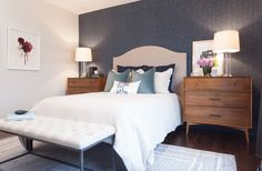Master bedroom with wallpaper feature wall | HGTV's Income Property