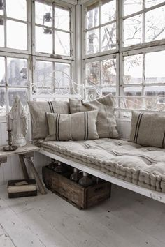beautiful white iron daybed with maybe UO cushion, feels so soft and comfy.  consider storage one side, daybed another.