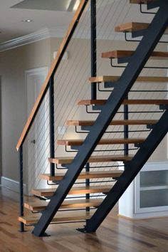 30 Beautiful Metal Stairs Ideas In 2019 Browse photos of staircases and discover design and layout ideas to inspire your own staircase remodel, including unique railings and storage options. Wood Railings For Stairs, Modern Stair Railing, Stair Railing Design, Concrete Stairs, Modern Staircase, Metal Stairs, Staircase Ideas, Iron Staircase, Spiral Staircases