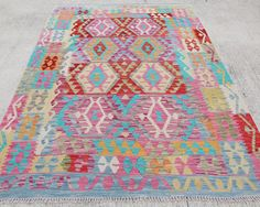 Meymaneh Kilim, handmade with natural wool in north west of Afghanistan.  This kilim is new, professionally cleaned and ready to use.  Origin: Afghanistan  Materials: 100% Wool Stock Code: KI 293  Size: 195 x 155 cm / 6.3 x 5 ft     All pictures are taken by daylighting in order to be better.  All our carpets are 100% handmade and may not be perfectly rectangular or evenly straight due to being handmade.  Feel free to contact us for any informations.