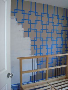 Painting a wall with paint tape, better than wallpaper because you can just paint over it when you want to change!