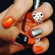 Super cute polka dot Halloween nail design