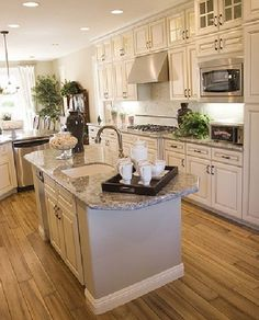 539869074052561142 For the kitchen makeover   white painted cabinets with choc. glaze and dark handles and add skinny cabinets to ceiling. Also, floor color I want.