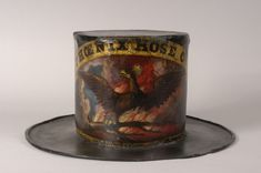 A fireman's hat dating to around 1860 was decorated for the Phoenix Hose Company of Philadelphia by David Bustill Bowser, African American emblem maker and Colored Troops flag designer. Original Star Spangled Banner, American History Museum, Fire Prevention Week, Fireman Hat, Fire Helmet, Fire Equipment, Forging Metal, Exhibition Space, 19th Century