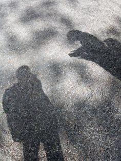 Shadows of People and a Tree | Shadow Silhouette of two people and a tree in the twilight of the gravel near K21 art museum in Düsseldorf.