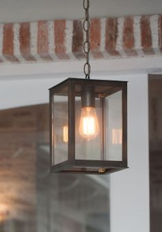 Lanes Ceramic Works klompie bricks creating a border in the background and a hanging brass lantern with Edison Squirrel bulb in the foreground Brass Lantern, Knysna, How To Make Light, Entrance Hall, Bricks, Squirrel, Lanterns, Kitchens, Bulb