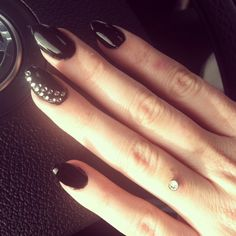 New Years Nails. Almond shaped black nails. Dermal piercing. Wedding ring. Claws.