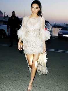 Kendall Jenner in a marabou-trimmed coat and matching dress for Cannes.
