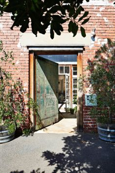 The entrance to Nina and Patrick's Melbourne home on Offspring. This door to their front courtyard is incredible. Like the gate to a secret garden. Warehouse Office, Converted Warehouse, Warehouse Home, Warehouse Conversion, Warehouse Apartment, Converted Barn, Turbulence Deco, Front Doors, Garage Doors
