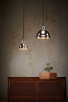 A classic-shaped pendant light in antique silver or antique brass finish. Medium shade: Ø 22cm x 18cm H $99