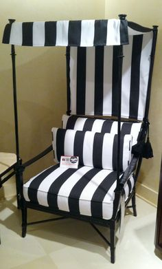More outdoor charm by Century Furniture.. This Royal Black and White Stripe Canopy arm chair in sunbrella fabric is a statement piece for any garden or deck as well as a very cozy reading nook in the most regal style possible. The finishing is exquisite! #HPMkt #StyleSpotters www.dec-a-porter.blogspot.com