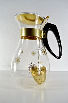 Winter SALE - Starburst Pyrex Glass Teapot Decanter with Infuser. 35.70, via Etsy.
