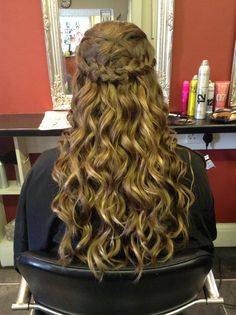 Wand waves. Secured below the crown with braids from the front wrapping around to the back. Hair by Jac