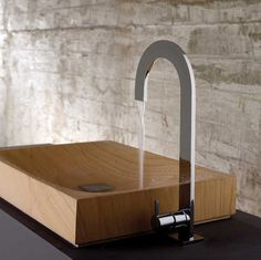 Bandini // Gorgeous wooden sink basin with a mod faucet