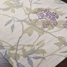 Amelia Rug  DETAILS  Add a pop of pattern to your living room or den with this hand-tufted rug, showcasing a botanical-inspired motif in parchment. Product:	Rug Construction Material:	100% Polyester Color:	Parchment, olive, mauve, iris and taupe