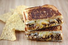 oh Lordy...Taco Grilled Cheese with taco meat, two different cheeses and tater tots..really!!!  The Year of the Sandwich!