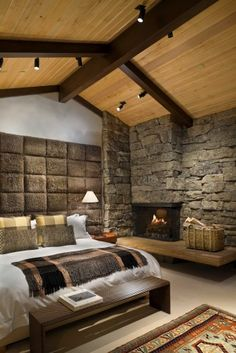 Love the rustic stone, rusticated concrete blocks, wooden beams and plank ceiling.  Want a cabin like this.