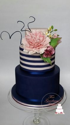 Navy blue striped cake with fringed peony by Forgoodnesscakeinks