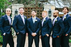 Don't these groomsmen look handsome in their classic navy suits?! We sure think so! Check out more of Alli and Alec's organic outdoor Austin wedding captured by Ashley Bosnick Photography. Florals by Bella by Sara.