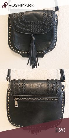 707a677ac3f Black tassel crossbody Nice size - has tassle on the front and zipper on  the back.