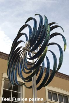 Mark White's Wind Ripples kinetic wind sculpture is on view at Santa Fe's Drury Inn!