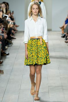 This French-cuffed button-down paired with sunny, flower-dotted skirt -- marrying two trends for spring. Michael Kors Spring 2015 RTW. #nyfw #MichaelKors #spring2015
