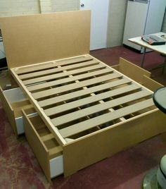 Bed with storage boxes underneath on wheels