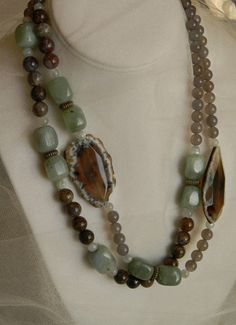 Long single strand handmade beaded necklace with two large agate chunks and celadon color jade nuggets. Beaded jewelry with grey quartz beads, jasper and moonstone beads and closing with an antiqued brass lobster clasp, handmade necklace with gemstone beads