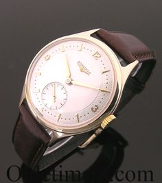A 9ct gold round vintage Longines watch, 1959