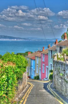 Colorful row houses in The Mumbles by Oystermouth Photography. Shared by Motorcycle Fairings - Motocc Swansea Bay, Swansea Wales, Wales Uk, South Wales, City Photography, Landscape Photography, Wales Tourism, Wales Holiday, Photo On Wood
