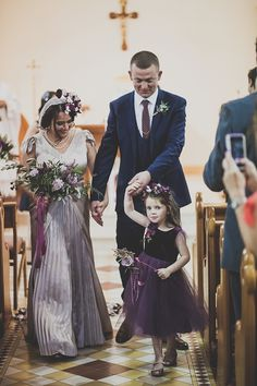 Flower girl wears a purple dress    Photography by http://marymcquillanphotography.com/