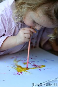 Straw blown art for kids. Make the paint dance across the paper! I have a feeling this could get *very* messy with my kids... something to do in the summer, though.  Outside.  lol