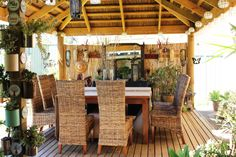Homely decorative inside view of an African Thatch #entertainmentarea #outdoorliving