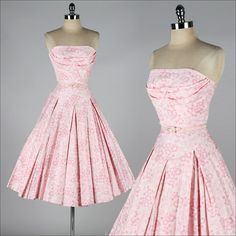 vintage 1950s dress    * pink floral polished cotton  * tulle skirt lining  * shelf bust  * matching belt  * metal back zipper  * by Nardis of