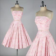 vintage 1950s dress    * pink floral polished cotton  * tulle skirt lining  * shelf bust  * matching belt  * metal back zipper  * by Nardis of