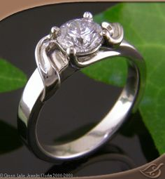 Raised Ribbon Wrap Mounting #engagement #jewelryworks. Beautiful shapes, like how prongs work into the jewelry design.