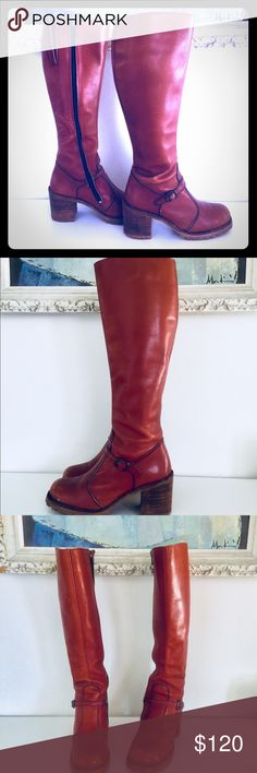 """Vintage 70s Oxblood Leather Campus Boots 7.5 Super cool oxblood leather knee-high boots, made in Argentina by Kinney Shoes.  They have a strap and buckle at the ankle, the heels are le stacked wood and they have a lug  rubber sole. The interior is suede. These are well made boots and high quality leather.     Material: Leather, wood, rubber  Brand: Kinney Shoes  Origin: Argentina   Era: 70s  Size: 7.5    .5"""" Platform Toe  3"""" Heel  15"""" high  14.5"""" around the calf, with 1.5"""" elastic dart…"""