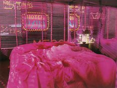 "Mishima: A Life in Four Chapters Directed by Paul Schrader, Production Design by Eiko Ishioka. Above: The lover's bedroom in a cheap ""love hotel"" in downtown Tokyo. As a private joke, Eiko had the neon sign made to read ""Hotel America"" in Japanese. Pink Hotel, Eiko Ishioka, Tout Rose, Tokyo Hotels, Neon Aesthetic, Aesthetic Bedroom, Neon Lighting, Set Design, Wall Collage"