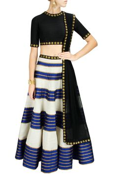 This lehenga set features a black tussar silk blouse with gold sequins floral motifs and cut out back along with blue and beige lehenga made of raw silk and tussar silk with gota lines and sequin embellished waist. It is paired with black net dupatta with borders. The lehenga has can can underlayer.