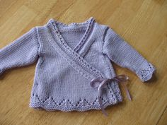 Also need: one small button; and 25 inches of 1/2 inch-wide satin ribbon in shade to match yarn