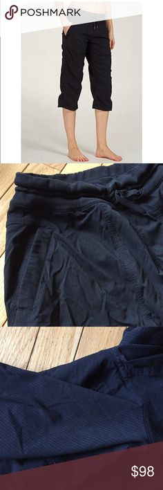 "Lululemon black dance studio crop pant Sz 8 Original discontinued pant. Unlined, 2 front pockets, subtle pinstriping, stretchy thick waist band with adjustable cord. Leg hem is loose and has adjustable cord for cinched rouching. Some wear, material in crotch shown, nothing major. 19"" inseam. These are the best for everyday - so sad they don't fit anymore! l lululemon athletica Pants Capris"