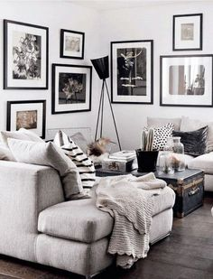 I love how the art on the wall follows the line of the sofa and makes it so much more interesting than your average corner of a room. This is monochrome living at its best.