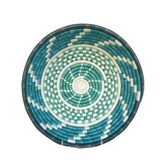 Fair Trade Rwandan Basket. Overview: Pool Blue Rain Basket. Intricately woven. Craftswomen in Rwanda use timeless tradition to weave carefully dyed sisal fibers and sweet grass to make stunning one of a kind pieces rich in cultural meaning and purpose. They are just the right size for a center piece, fruit bowl, or wall hanging. Product Meaning & Purpose: Baskets carry their own symbolism in Rwanda. Because friends give them to celebrate major life events such as weddings, births and...