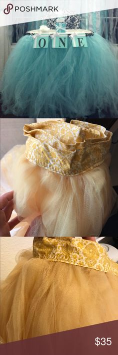 Gorgeous Tulle/Tutu (Floor Length) Brand New! Gorgeous floor length tulle gold color in pristine/brand new condition. Can be used for high chair or as part of an outfit. Don't miss this one of a kind Tulle! Fits a standard height high chair. Accessories