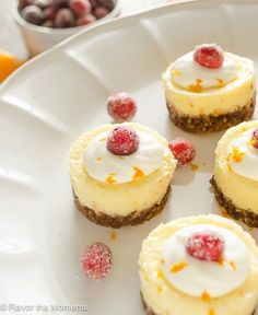 Mini Cranberry Orange Cheesecakes are creamy bite-sized cheesecakes bursting with holiday flavor!