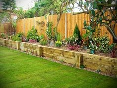 Raised border. Would keep the dogs away from nice plants and from digging under the fence, I like this idea!